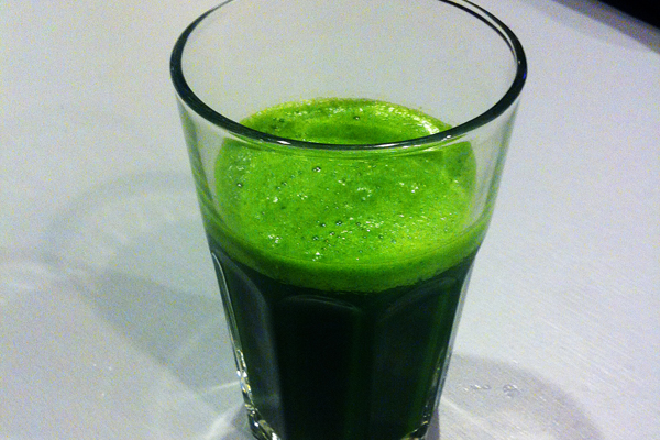 I now drink green juice almost every day (this is a shot of black kale and apple juice).