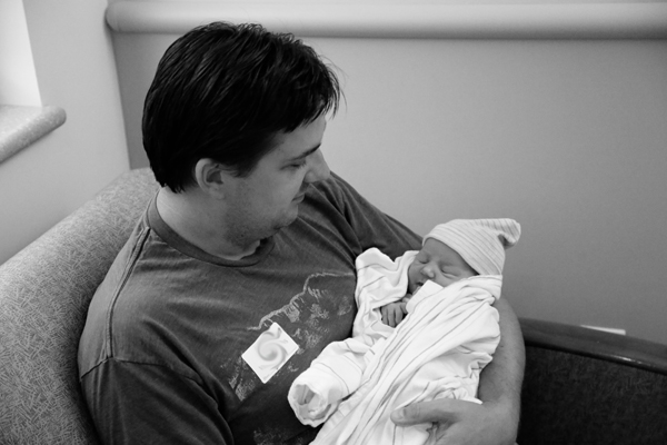 David meeting his new niece. He's a first time uncle too!
