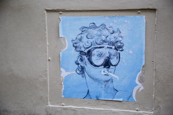 Scuba Dave plastered to the wall outside of Galleria dell'Accademia