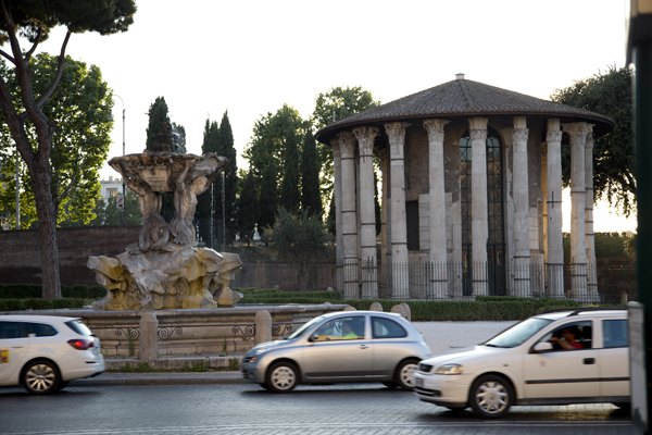 Fountain of Tritons and Temple of Ercole which are situated across the street from the Bocca della Verità