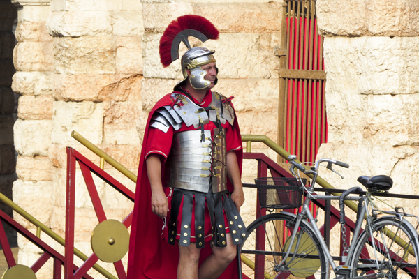 An actor dressed as a Roman Soldier