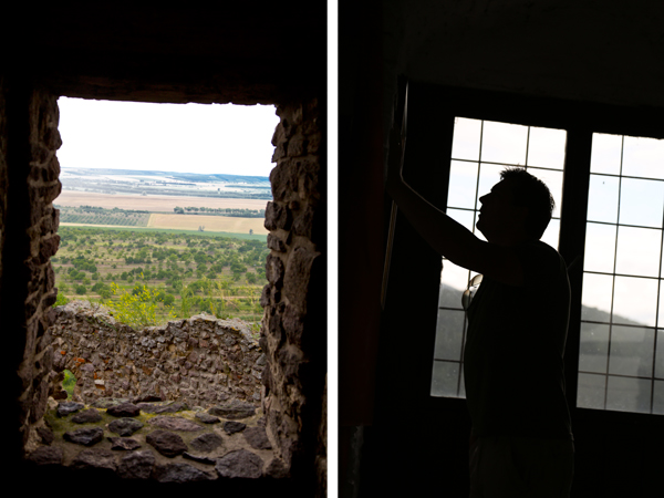View from a castle window and David reading a map on the wall.
