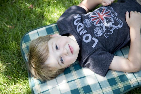 Little Man relaxing in the yard