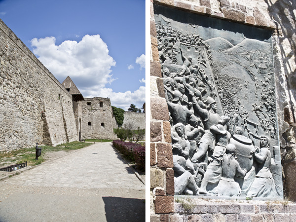 The castle walls and a monument dedicated to the women who helped protect the castle
