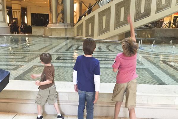 Three boys = three coins in the fountain