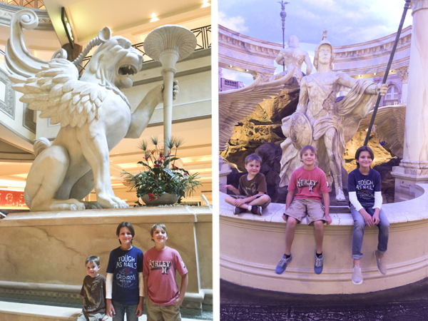 Stopping to rest and posing in front of the forum shops' many statues