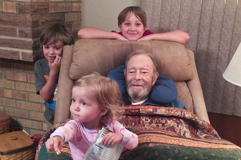 With his great-grandchildren on the night before he died.